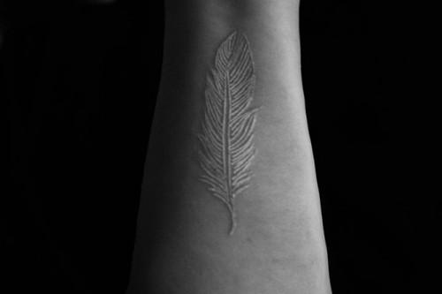 tattoo witte veer
